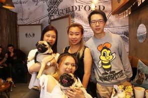 family altogether at pop up pug cafe