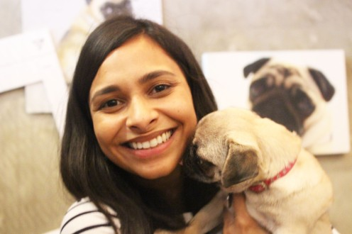 lady holds pug puppy at pop up pug cafe