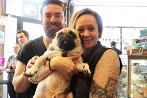 couple at pop up pug cafe