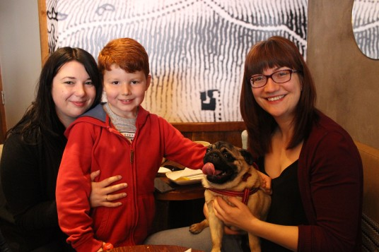 family with child at pop up pug cafe