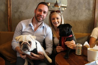 family with their pugs at pop up pug cafe