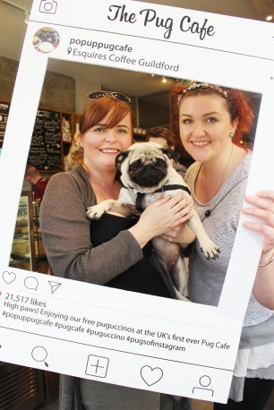 two women with their pug at pop up pug cafe