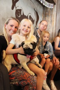 small girl and pug at pop up pug cafe