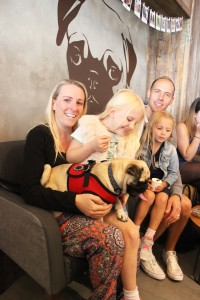family at pop up pug cafe