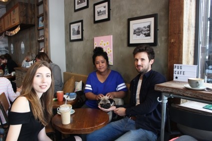 group of friends at at pop up pug cafe