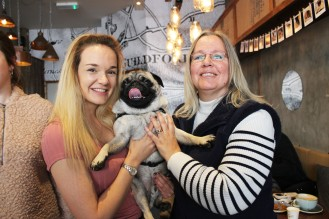 mother and daughter with their pug at pop up pug cafe