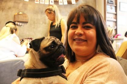 owner with her pug at pop up pug cafe