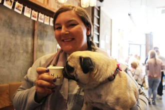 lady and her pug at pop up pug cafe