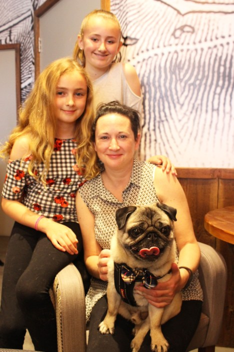mother and daughters at pop up pug cafe