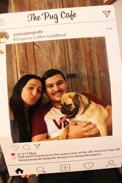 family having fun at pop up pug cafe