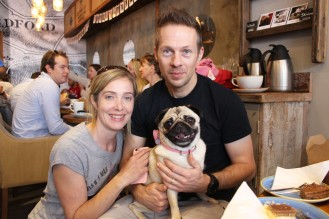 couple with their pug at pop up pug cafe