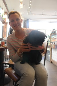 owner with pug on their lap at pop up pug cafe