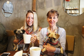 mother and daughter with their pugs at pop up pug cafe