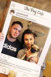 family with pug puppy at pop up pug cafe
